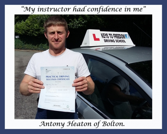 Antony Heaton of Bolton, posing by the car with his pass certificate, after his first time pass. With Keys to Freedom Driving School.