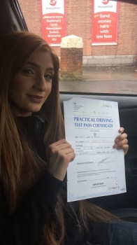 Congratulations to Iqra passing her driving test with <br />