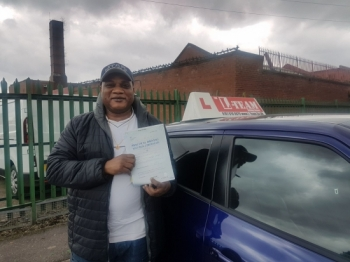 Congratulations to Idrisa passing his driving test with<br />